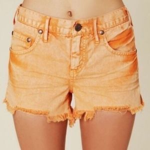Revolve FP Ripped Denim Cut Off Short in Melon
